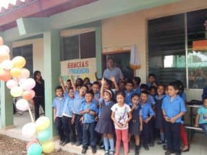 Wayne Waite with children at the Good Shepherd Bilingual School