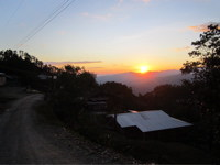 One of the many beautiful sunsets with the volunteer house in the foreground