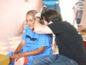 Thomas examining a patient